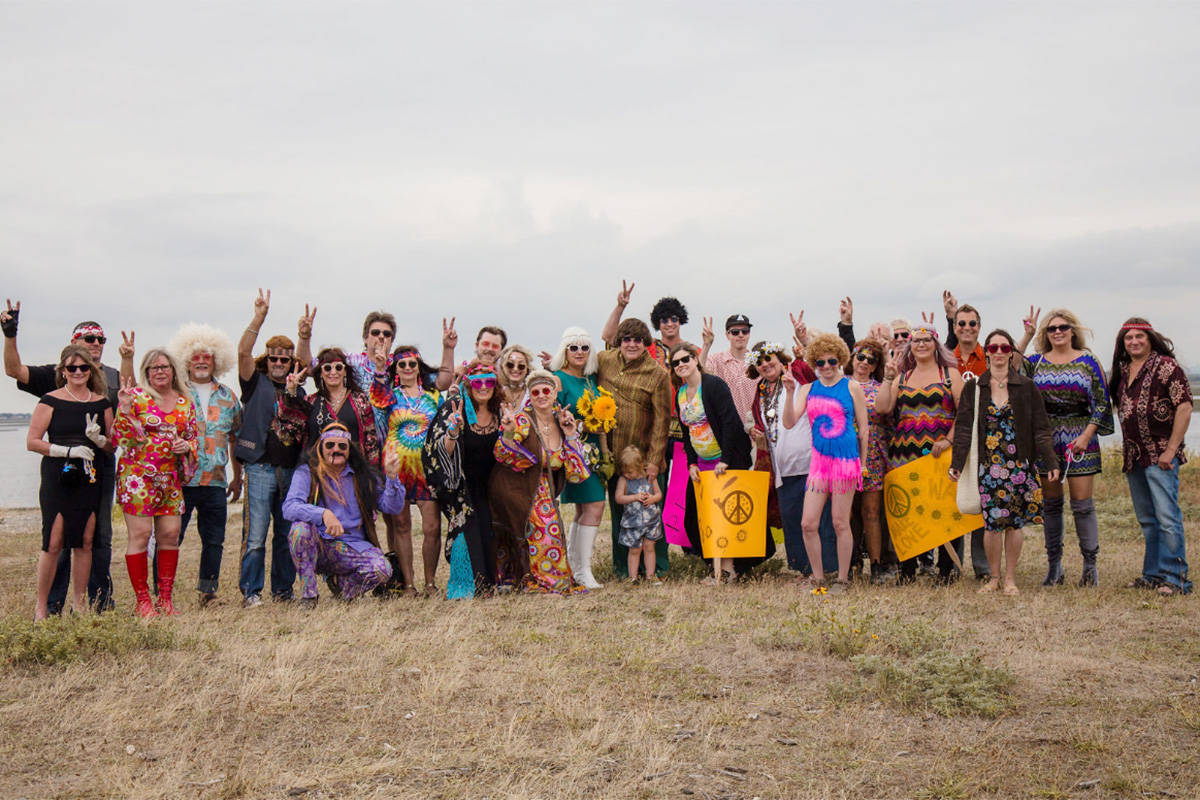 James Rockwell and his wife Lidia are photographed with the guests of their themed Woodstock wedding. (Taylor Leigh Photography)