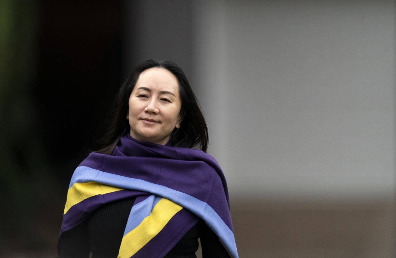 Chief Financial Officer of Huawei, Meng Wanzhou leaves her home in Vancouver, Wednesday, October 28, 2020. Wanzhou is heading to the British Columbia Supreme Court in an evidentiary hearing on her extradition case on abuse of process argument. THE CANADIAN PRESS/Jonathan Hayward