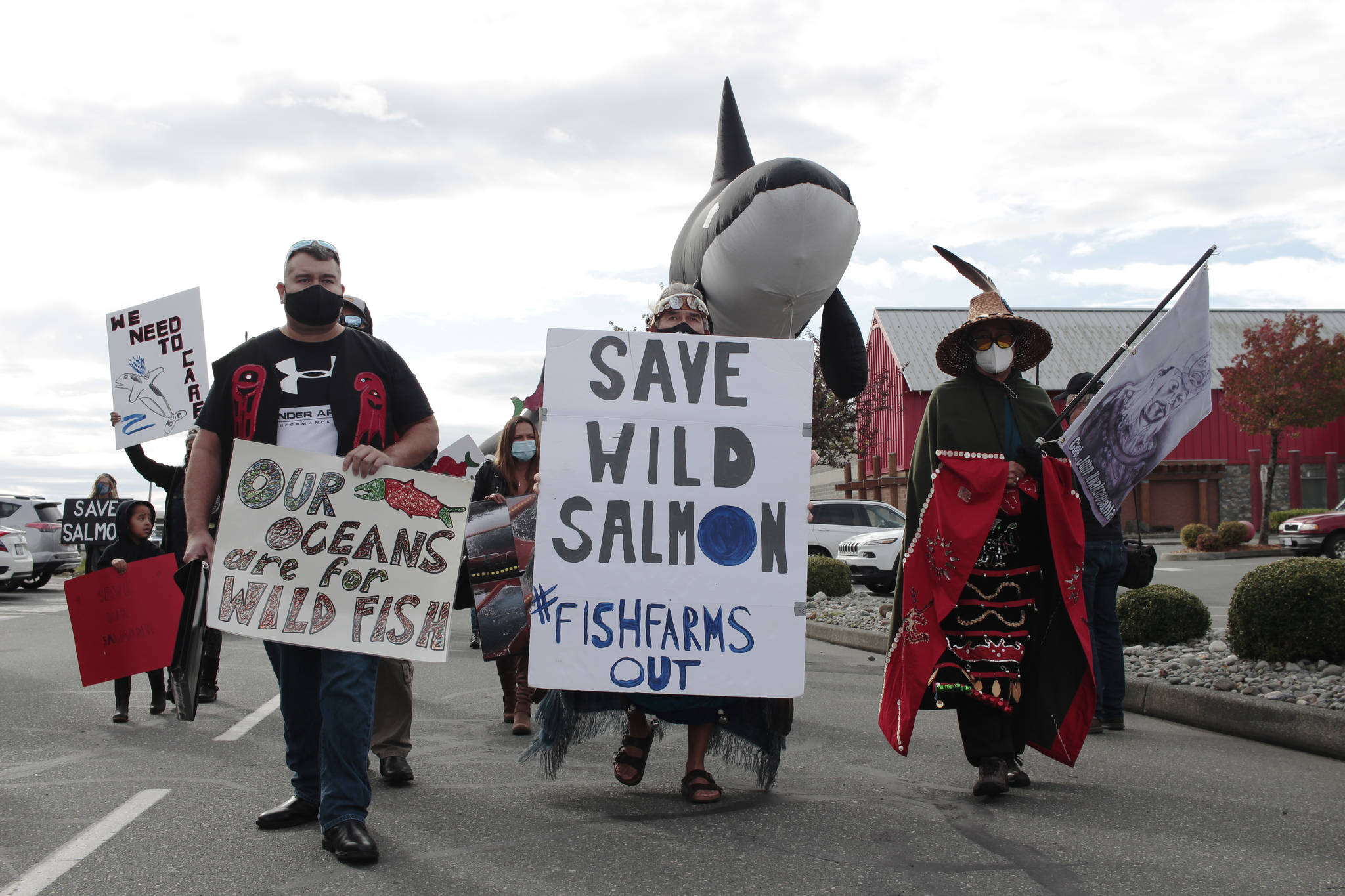 A Photo from Sept. 2020, when First Nations and wild salmon advocates took to the streets in Campbell River to protest against open-pen fish farms in B.C.'s waters. On Dec. 17, federal fisheries minister Bernadette Jordan announced her decision to phase out 19 fish farms from Discovery Islands. Cermaq's application to extend leases and transfer smolts was denied. (Marc Kitteringham/Campbell River Mirror)